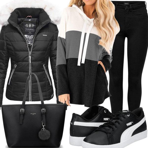 Schwarzes Frauenoutfit mit Steppjacke und Kapuzenpullover