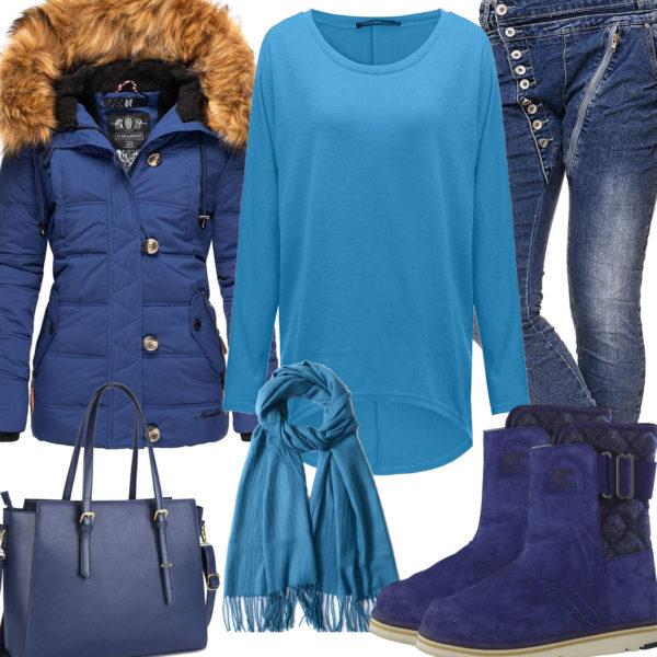 Blaues Frauenoutfit mit Winterjacke und Stiefeln