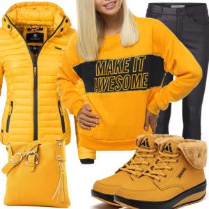 Gelb-Schwarzes Frauenoutfit mit Steppjacke und gefütterten Schuhen