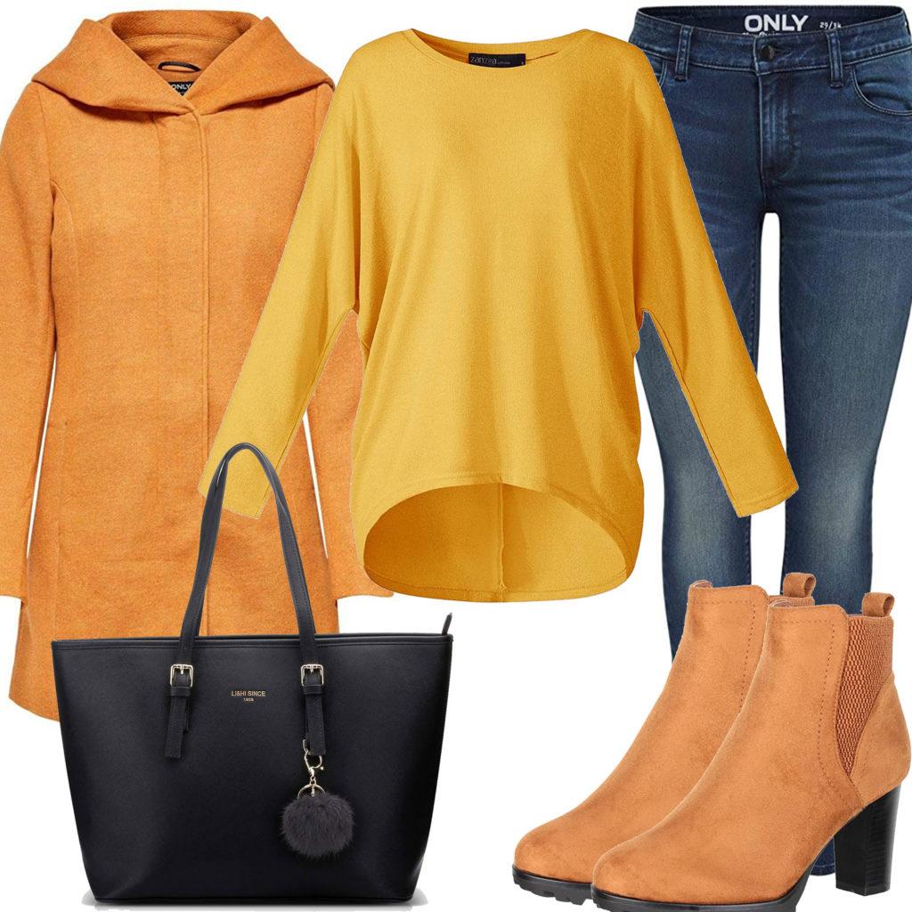 Gelbes Frauenoutfit mit Mantel, Pullover und Stiefeletten