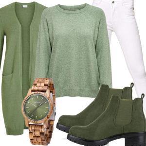 Grünes Frauenoutfit mit Strickjacke, Stiefel und Uhr