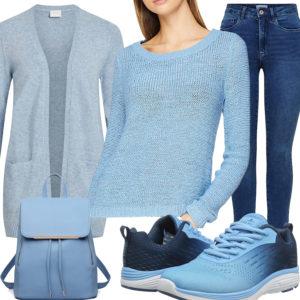 Lässiges Frauenoutfit mit hellblauem Pullover und Strickjacke
