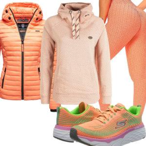 Oranges Damenoutfit mit Steppjacke, Hoodie und Leggings