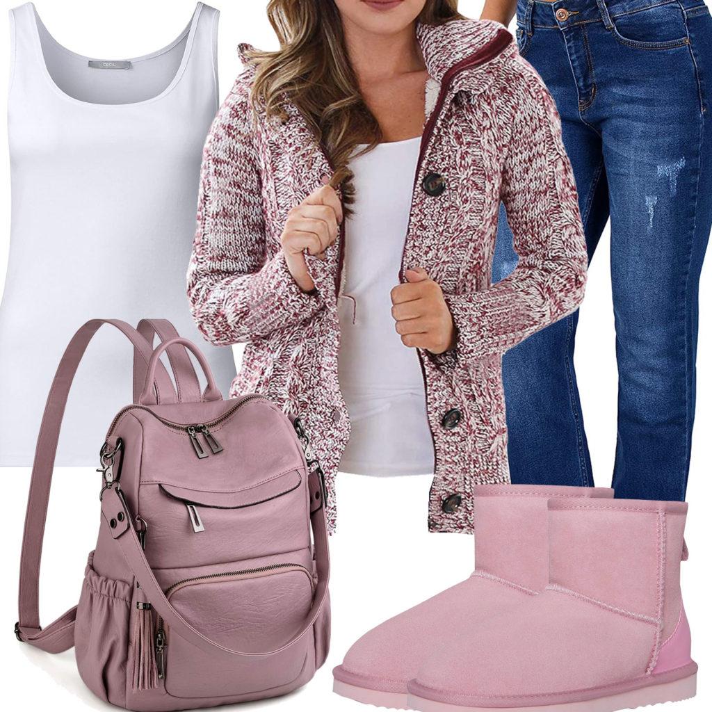 Rosa Frauenoutfit mit Strickjacke und Rucksack