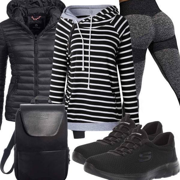 Schwarzes Frauenoutfit mit Leggings, Hoodie und Sneakern