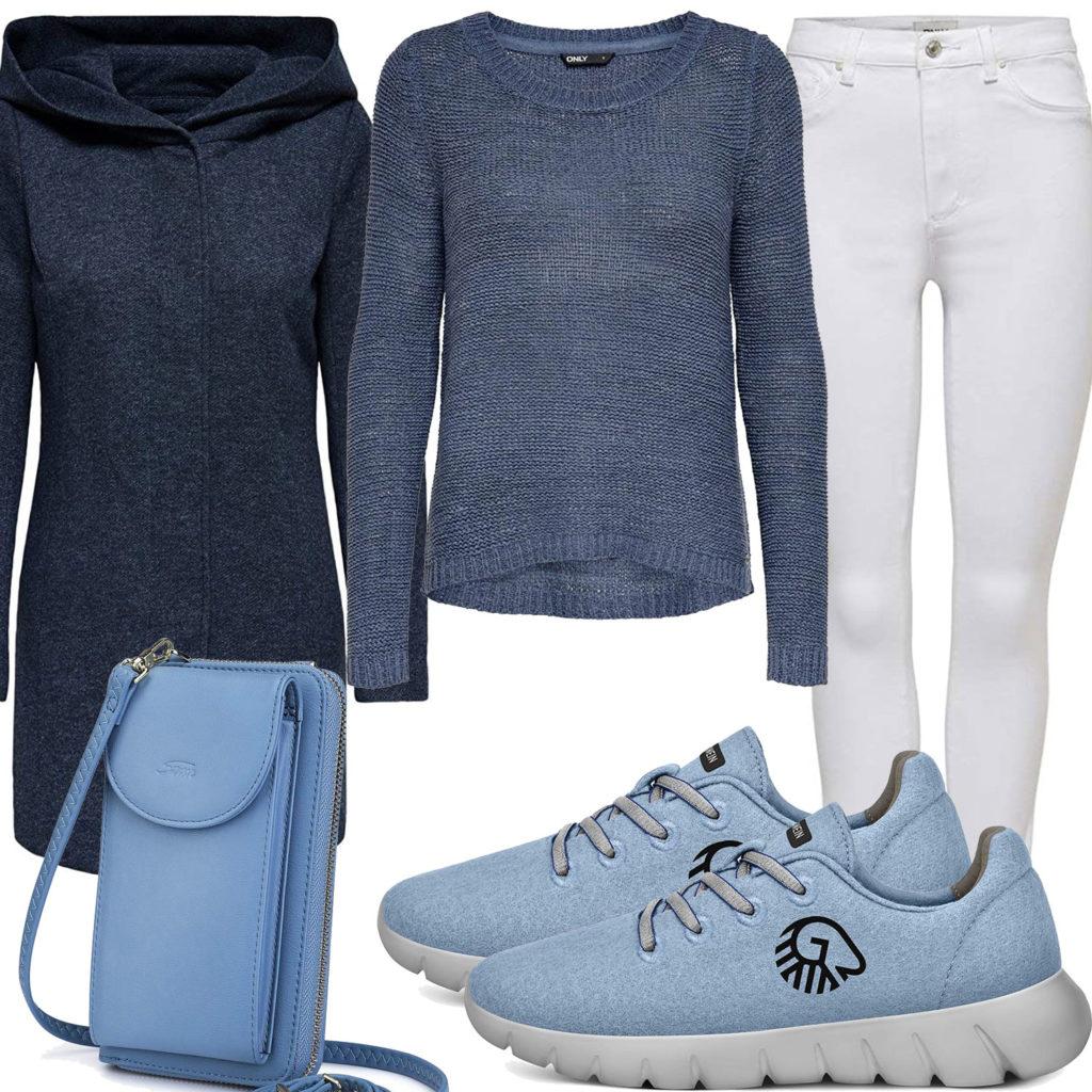 Blaues Frauenoutfit mit Wollmantel, Strickpullover und Sneakern
