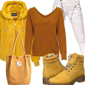 Gelbes Frauenoutfit mit Kunstpelzjacke, Tasche und Stiefeln