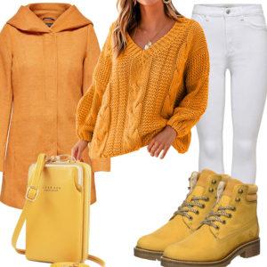 Gelbes Damenoutfit mit Wollmantel und Stiefeln