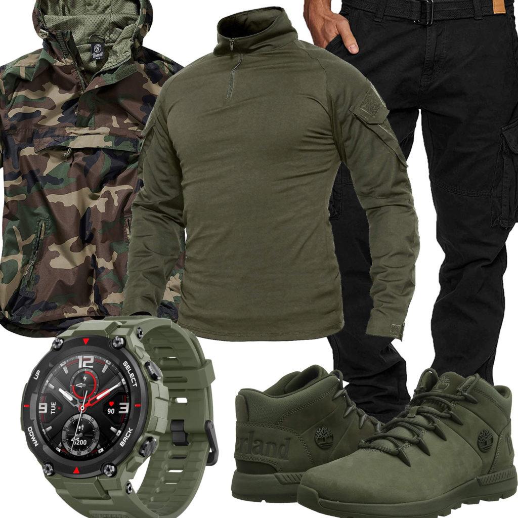 Grünes Herrenoutfit mit Camouflage Windbreaker und Uhr