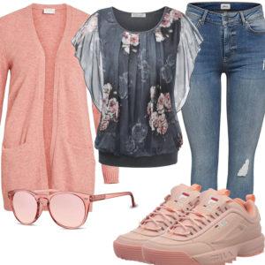 Frühlings-Frauenoutfit mit oranger Strickjacke und Sneakern
