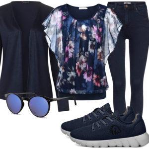 Dunkelblaues Frauenoutfit mit Bluse, Strickjacke und Jeans
