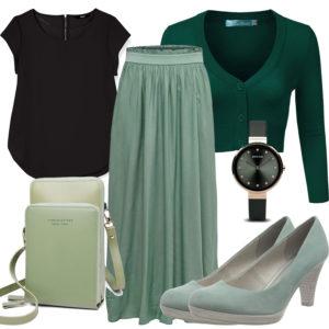 Damenoutfit mit grünem Rock, Strickjacke und Pumps