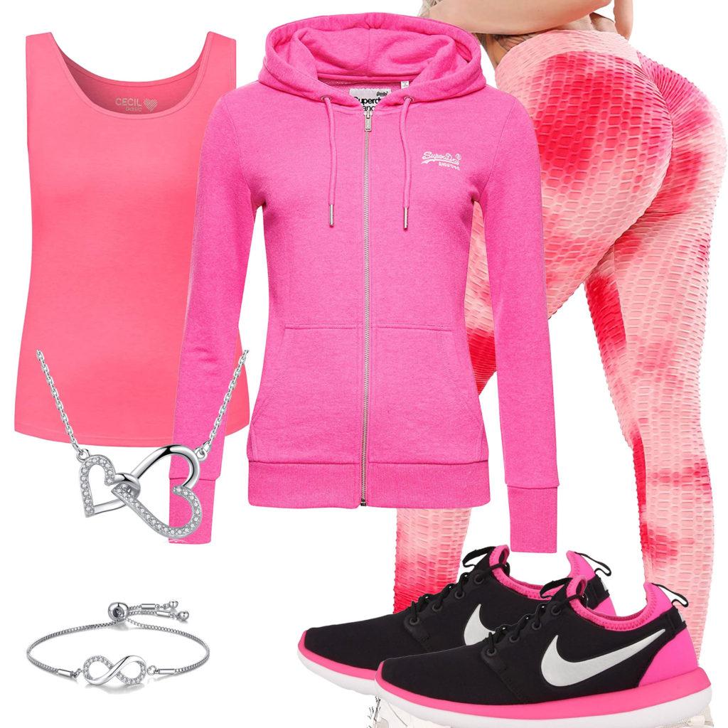 Sportliches Frauenoutfit mit pinker Leggings und Hoodie