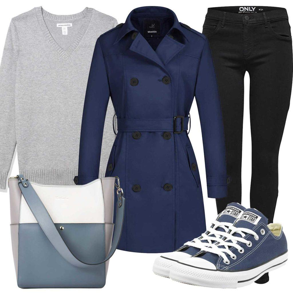 Damenoutfit mit dunkelblauem Trenchcoat und Sneakern